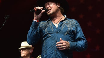 Tracy Byrd's keyboard player hospitalized after lighting rig crashes during performance