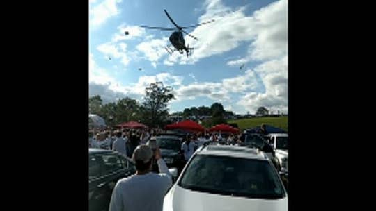 Penn State tailgate draws police helicopter that blows over tents, stirs debris