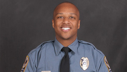 Atlanta-area officer fatally shot; one suspect held, another sought, authorities say