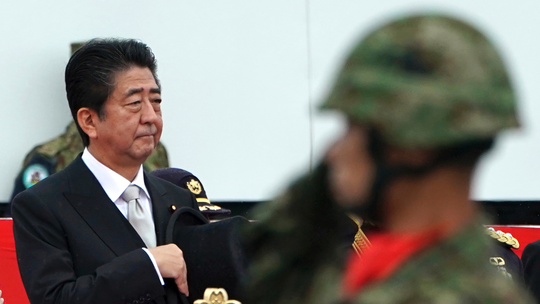 Abe renews pledge to change Japan's charter to boost troops