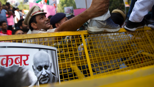 India's accused minister files defamation suit amid protests