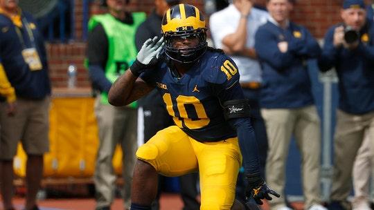 University of Michigan football star spotted damaging Michigan State's logo