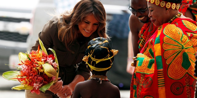 U.S. first lady Melania Trump greets a child during her visit at Cape Coast castle, Ghana, October 3, 2018. REUTERS/Carlo Allegri