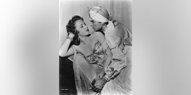 "American actress, Piper Laurie, then only 18, with Tony Curtis in ""The Prince Who was a Thief."""