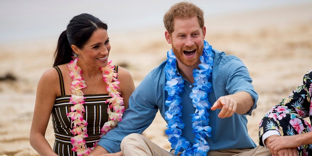 Britain's Prince Harry and Meghan, Duchess of Sussex meet with a local surfing community group, known as OneWave, raising awareness for mental health and wellbeing in a fun and engaging way at Bondi Beach in Sydney, Australia, Friday, Oct. 19, 2018. Prince Harry and his wife Meghan are on day four of their 16-day tour of Australia and the South Pacific. — AP
