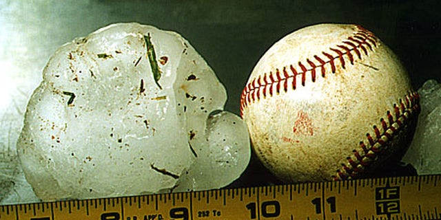 An Australian womansuffered severe bruises while protecting her baby from softball-sized hailstones on Thursday.