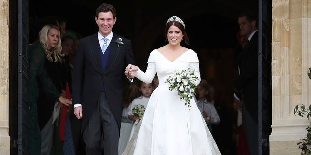 Princess Eugenie of York and Jack Brooksbank after their wedding ceremony at St George's Chapel, Windsor Castle, near London, England, Friday Oct. 12, 2018. (Steve Parsons, Pool via AP)