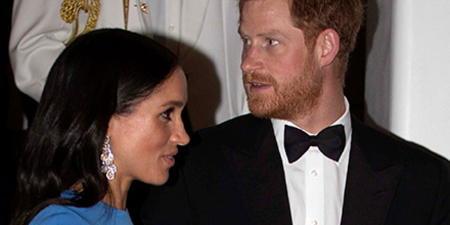 Britain's Prince Harry and Meghan, Duchess of Sussex at the official dinner in Suva, Fiji, Tuesday, Oct. 23, 2018. Prince Harry and his wife Meghan are on day eight of their 16-day tour of Australia and the South Pacific.