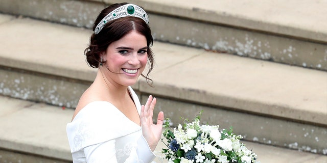 Princess Eugenie arrives for her wedding to Jack Brooksbank at St George's Chapel, Windsor Castle, near London, England, Friday Oct. 12, 2018. (Andrew Matthews, Pool via AP)