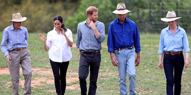 Britain's Prince Harry and Meghan, Duchess of Sussex visit a local farming family, the Woodleys, in Dubbo, Australia, Oct. 17, 2018. (Chris Jackson/Pool via AP)