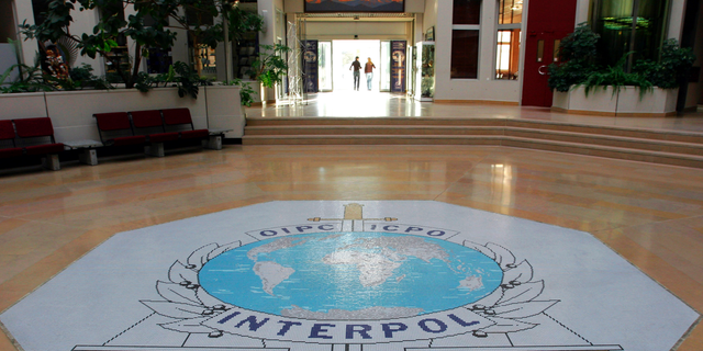 FILE - This Oct.16, 2007 file photo shows the entrance hall of Interpol's headquarters in Lyon, central France.
