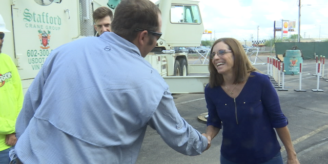 Rep. McSally touring a construction crane facility a week ahead of early voting.