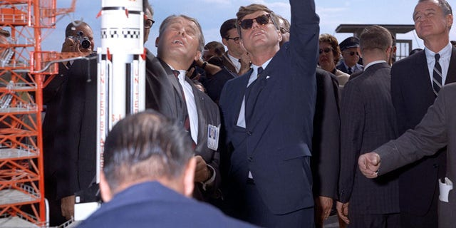 Dr. Werner Von Braun explains the Saturn system to President John F. Kennedy at Complex 37 while President Kennedy is on tour at the Cape Canaveral Missile Test Annex on Nov. 16, 1963.