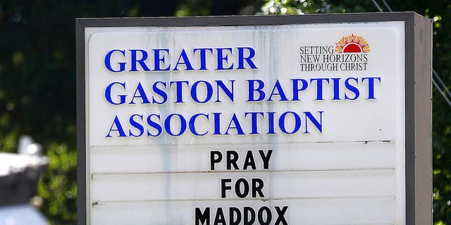 The message on the sign in front of the Greater Gaston Baptist Association office is shown Wednesday, Sept. 26, 2018, in Gastonia, N.C., near Rankin Lake Park where 6-year-old Maddox Ritch disappeared while visiting the park with his father Saturday, Sept. 22, 2018. (AP Photo/John Clark Gaston Gazette)