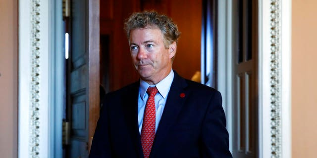 Sen. Rand Paul, R-Ky., leaves a meeting of Senate Republicans with Vice President Mike Pence, Wednesday, Sept. 26, 2018, on Capitol Hill in Washington. Paul has often clashed with Anthony Fauci in congressional hearings. (AP Photo/Jacquelyn Martin)