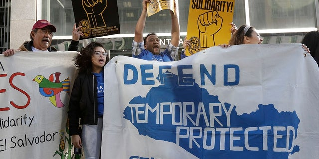 FILE: Supporters of temporary protected status immigrants before a news conference announcing a lawsuit against the Trump administration over its decision to end a program that lets immigrants live and work legally in the U.S.