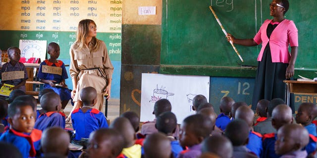 First lady Melania Trump sits with a student during language class as she visits Chipala Primary School, in Lilongwe, Malawi. (AP Photo/Carolyn Kaster)