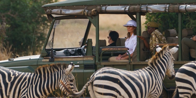 First lady Melania Trump observes zebras during a safari at Nairobi National Park in Kenya