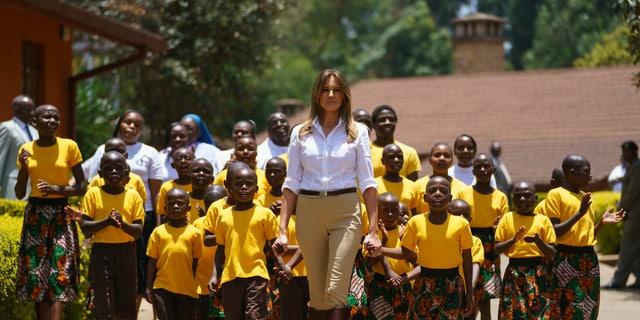 First lady Melania Trump walks with singing children as she visits the Nest Orphanage in Limuru, Kenya. (AP Photo/Carolyn Kaster)