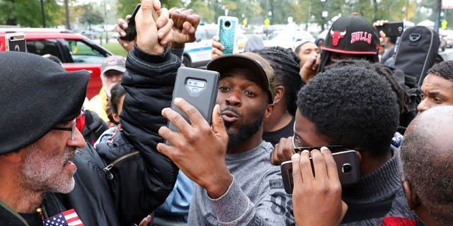 Protesters react in front of George N Leighton Criminal Courthouse Friday, Oct. 5, 2018, in Chicago. A jury on Friday convicted white Chicago police officer Jason Van Dyke of second-degree murder in the 2014 shooting of black teenager Laquan McDonald. (AP Photo/Nam Y. Huh)