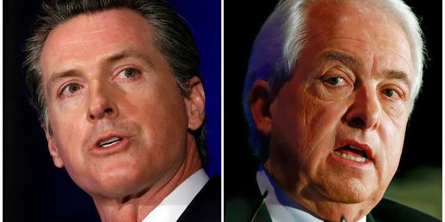 FILE: California gubernatorial candidates Lt. Gov. Gavin Newsom, left, a Democrat and Republican businessman John Cox in Sacramento, Calif.