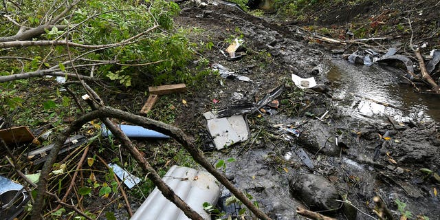 Debris scatters an area at the site of Saturday's fatal crash Schoharie, N.Y.