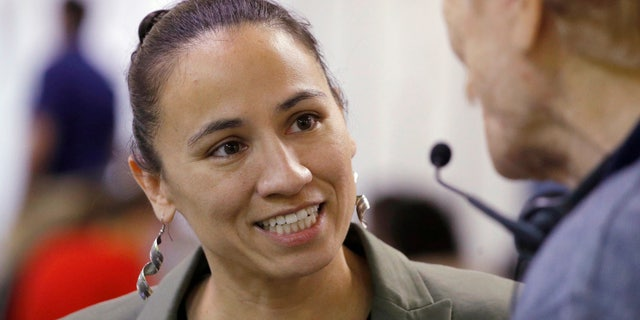 Democratic congressional candidate Sharice Davids could become the first lesbian Native American woman ever elected to Congress.