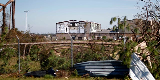 An airplane hanger at Tyndall Air Force Base is damaged from hurricane Michael.
