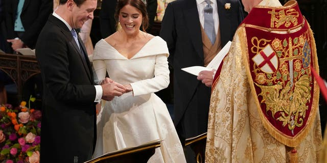 The Rt Revd David Conner, Dean of Windsor conducts the wedding ceremony between Princess Eugenie of York and Jack Brooksbank in St George's Chapel, Windsor Castle, near London, England, Friday Oct. 12, 2018. (Jonathan Brady, Pool via AP)