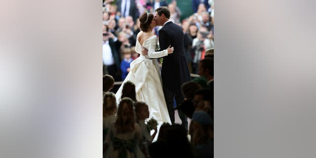 Princess Eugenie of York and Jack Brooksbank kiss after their wedding in St George's Chapel, Windsor Castle, near London, England, Friday Oct. 12, 2018. (Yui Mok, Pool via AP)