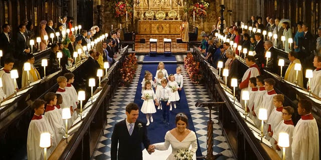Princess Eugenie of York and Jack Brooksbank after their wedding ceremony at St George's Chapel, Windsor Castle, near London, England, Friday Oct. 12, 2018. (Jonathan Brady, Pool via AP)