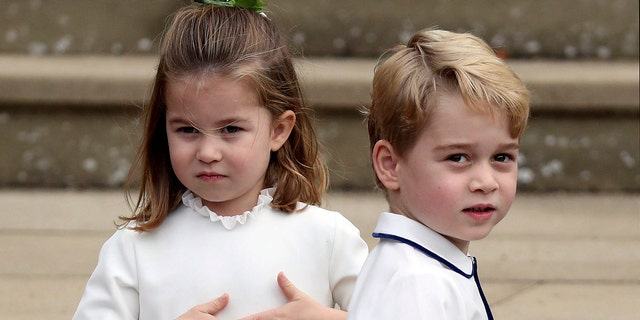 Prince George and Princess Charlotte arrive for the wedding of Princess Eugenie of York and Jack Brooksbank.