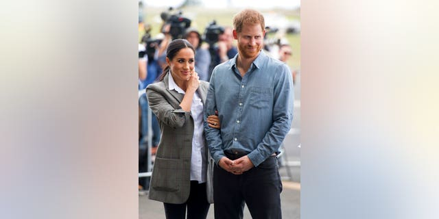 Duchess Meghan paired the blazer with a button-down shirt and black pants.