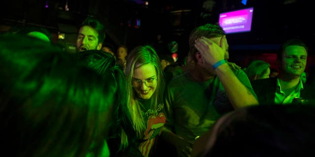 People celebrate at Leafly's countdown party as midnight passes and marks the first day of the legalization of cannabis across Canada in Toronto on Wednesday