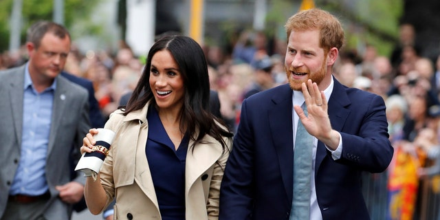 Britain's Prince Harry and Meghan, Duchess of Sussex arrive at the Royal Botanic Gardens in Melbourne, Australia, Thursday, Oct. 18, 2018. Prince Harry and his wife Meghan are on day three of their 16-day tour of Australia and the South Pacific. (Phil Noble/Pool Photo via AP)