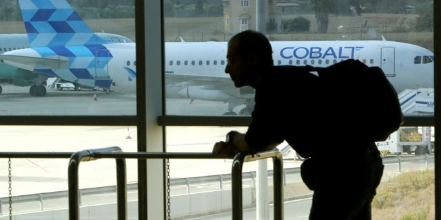 Cyprus-based airline Cobalt Air says it has indefinitely suspended all of its operations, Thursday, amid a struggle to find investors. (AP Photo/Petros Karadjias)