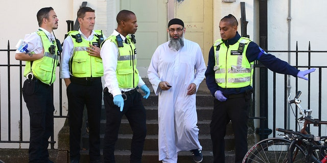 Anjem Choudary outside a bail hostel in north London after his release from Belmarsh Prison. (David Mirzoeff/PA via AP)