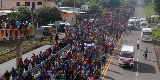 Central American migrants walking to the U.S. start their day departing Ciudad Hidalgo, Mexico, Sunday, Oct. 21, 2018. Despite Mexican efforts to stop them at the border, about 5,000 Central American migrants resumed their advance toward the U.S. border early Sunday in southern Mexico.