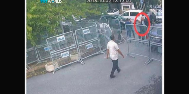 This image, obtained by the Turkish broadcaster TRT World purportedly shows Saudi journalist Jamal Khashoggi before passing barriers that block the road leading to the Saudi consulate, in Istanbul.