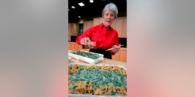 Reilly was a Campbell Soup kitchen supervisor in 1955 when she combined green beans and cream of mushroom soup, topped with crunchy fried onions, for an Associated Press feature. It is the most popular recipe ever to come out of the corporate kitchen at Campbell Soup. (AP Photo/Mel Evans, File)