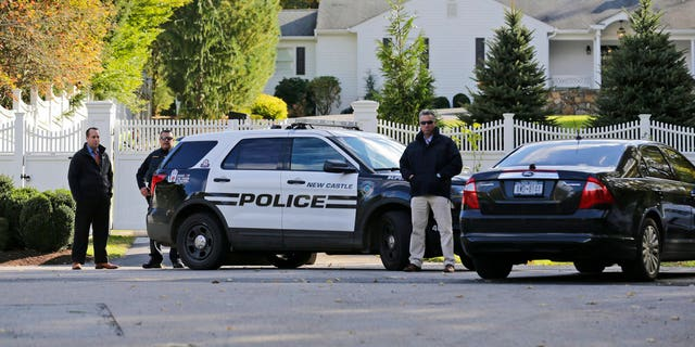 "Police officers stand in front of property owned by Hillary and Bill Clinton in Chappaqua, N.Y., Wednesday, Oct. 24, 2018. A U.S. official says a ""functional explosive device"" was found at the Clinton's suburban New York home. (AP Photo/Seth Wenig)"
