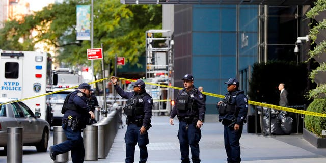 New York City Police Dept. officers arrive outside the Time Warner Center, in New York, Wednesday, Oct. 24, 2018.<br> 