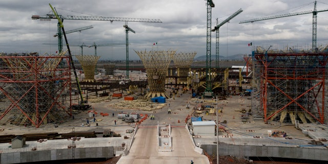 """This Oct. 17, 2018 photo, shows the advances in the construction of new airport in Texcoco, Mexico. The site is a hive of activity. Twenty one massive """"funnels"""" that will support the terminal were under construction beneath more than a dozen cranes. (AP Photo/Miguel Tovar)"""