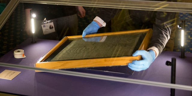 The Salisbury Cathedral 1215 copy of the Magna Carta is installed in a glass display cabinet marking the 800th anniversary of the sealing of Magna Carta at Runnymede in 1215, in Salisbury, England. (AP Photo/Matt Dunham, FILE)
