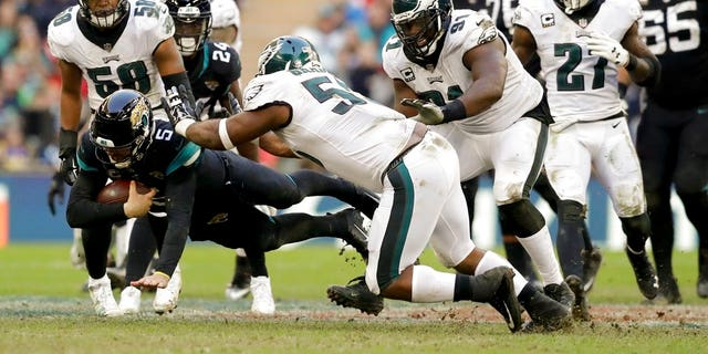 FILE: Jacksonville Jaguars quarterback Blake Bortles dives to make a down during the second half of an NFL football game against Philadelphia Eagles at Wembley stadium in London.