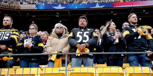 Pittsburgh Steelers fans stand for a moment of silence for the victims of a deadly shooting spree at a synagogue on Saturday before the start of an NFL football game against the Cleveland Browns, Sunday, Oct. 28, 2018, in Pittsburgh.