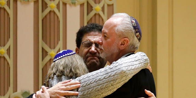 Rabbi Jeffrey Myers, right, of Tree of Life/Or L'Simcha Congregation hugs Rabbi Cheryl Klein, left, of Dor Hadash Congregation and Rabbi Jonathan Perlman during a community gathering held in the aftermath of a deadly shooting at the Tree of Life Synagogue in Pittsburgh, Sunday, Oct. 28.