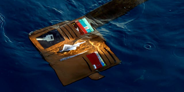 FILE: A wallet belonging to a victim of the Lion Air passenger jet that crashed is seen in the waters of Ujung Karawang, West Java, Indonesia.