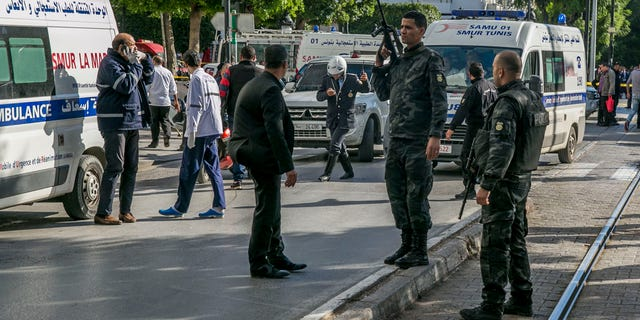 Tunisian police officers secure the site of an attack after a 30-year-old woman blew herself on the Habib Bourguiba avenue in Tunis, Tunisia. (AP Photo/Riadh Dridi)