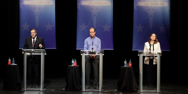Democratic Sen. Joe Donnelly, Republican former state Rep. Mike Braun and Libertarian Lucy Brenton, from left, participate in a U.S. Senate debate. The Indiana Democratic Party sent a mailer to voters last week comparing Brenton to Braun, saying she is the better choice for those who want lower taxes.